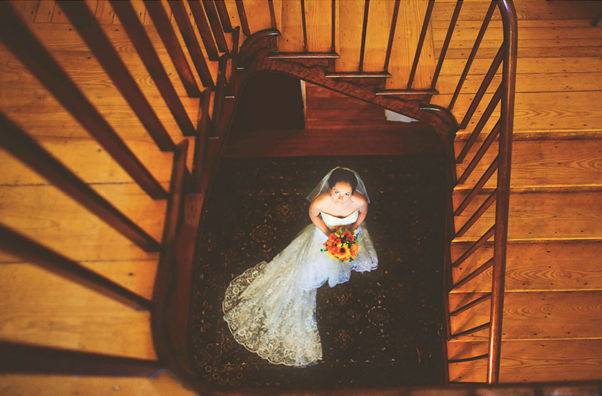 Wedding Bride Standing at Bottom Of Stairs