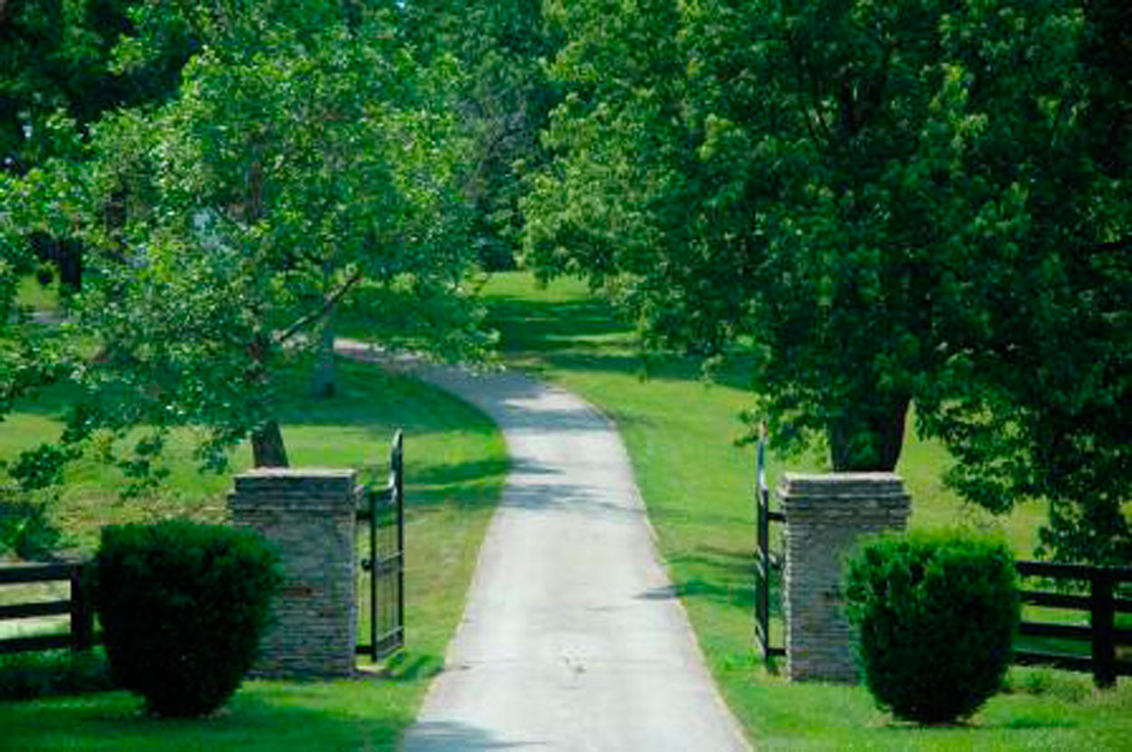 Country Road leading to Two Door Gate