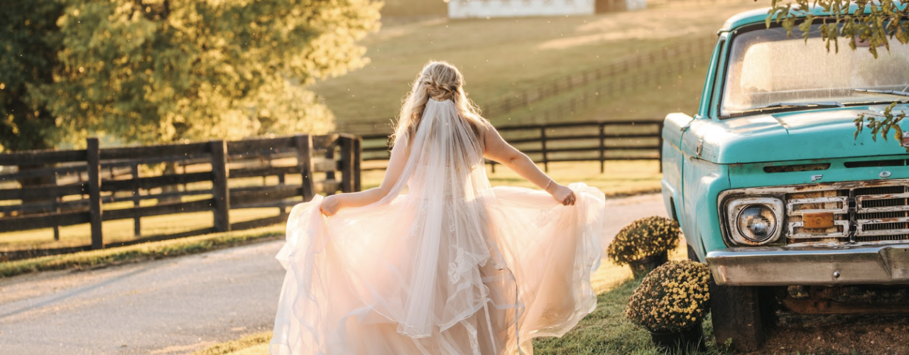 Wedding Bride Standing next to Horse